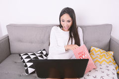 Woman watching movies with laptop. Stock Image