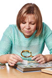 Woman watching postage stamps Stock Photos