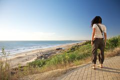 Woman watching Roche beach. Roche beach at Cadiz Andalusia in Spain Royalty Free Stock Photos
