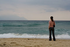 Woman watching sea Royalty Free Stock Photos