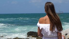 Woman watching the sea stock video footage