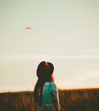 Woman Watching The Sky During A Sunset