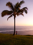 Woman watching sunrise in Kauai Stock Photography