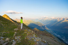 Woman watching sunrise over the Alps in Valle d'Aosta, Italy Royalty Free Stock Images