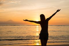 Woman watching sunset Stock Photography