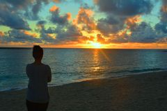 Woman watching the sunset Royalty Free Stock Photography