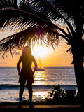 Woman watching the sunset in Phuket Stock Images