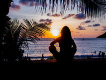 Woman watching the sunset in Phuket Royalty Free Stock Photography