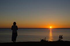 Woman watching sunset Royalty Free Stock Image