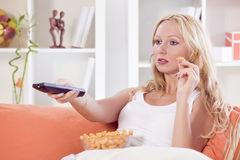 Woman watching television Stock Images