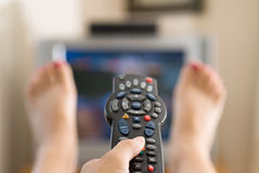 Woman watching television Royalty Free Stock Image
