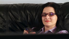 Woman watching television stock video footage