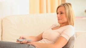 Woman watching television Royalty Free Stock Photos