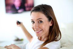 Woman watching television Royalty Free Stock Photography