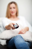 Woman watching television Stock Photography