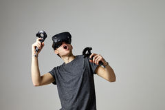 Woman Watching Television Wearing Virtual Reality Headset stock photo