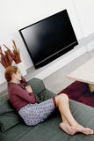 Woman watching television a Royalty Free Stock Images