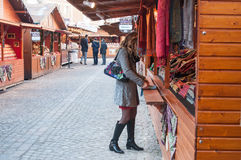 woman watching  textile assortment in christmas market Royalty Free Stock Photo