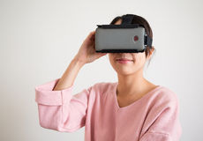 Woman watching though virtual reality device Stock Image