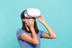 Woman watching though VR device and feeling frighten Stock Image
