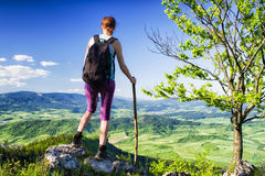 Woman watching from top of the hill, Slovakia. Hiking woman watching from top of the hill Hrdos Ostre and watching on beautiful summer landscape. Region Orava royalty free stock photo