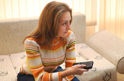 Woman watching TV Stock Images