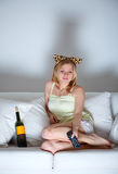 Woman Watching TV. Beautiful lonely woman sitting on couch and watching tv Royalty Free Stock Photos