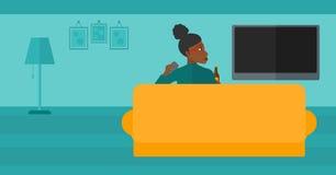 Woman watching TV. Stock Photos
