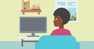 Woman watching TV. Royalty Free Stock Image