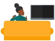 Woman watching TV Stock Image