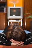 Woman watching TV Stock Image