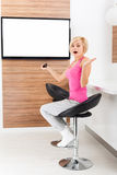 Woman watching tv negative emotion scared Royalty Free Stock Photo