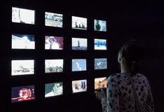 Woman watching on tv screens Royalty Free Stock Photo