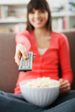 Woman watching tv Stock Photography