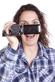Woman watching video camera smile Royalty Free Stock Photos