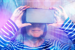 Woman watching 360 video with virtual reality headset Stock Image