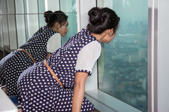 Woman watching the view from skyscraper Stock Photo