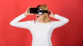 Woman watching virtual reality vision. Woman with virtual reality headset. The woman with glasses of virtual reality. VR. Vision stock images
