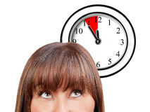 Woman watching wall clock five minutes deadline isolated Royalty Free Stock Photo