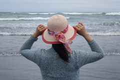 Woman watching waves on Pacific Ocean Royalty Free Stock Images