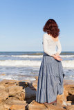 Woman watching waves Royalty Free Stock Photo