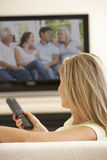 Woman Watching Widescreen TV At Home Stock Images