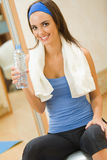 Woman with water. Doing fitness exercises at home Stock Photos