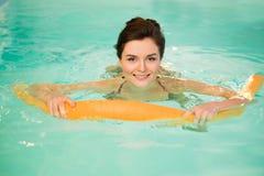 Woman on water aerobics Royalty Free Stock Image