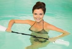 Woman on water aerobics Royalty Free Stock Photo