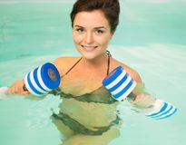 Woman on water aerobics Stock Photo
