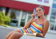 Woman with water bottle Stock Images