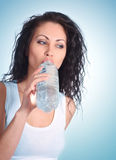 Woman with water bottle Royalty Free Stock Images