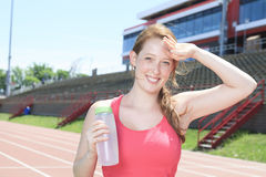 Woman with water bottle stock photography