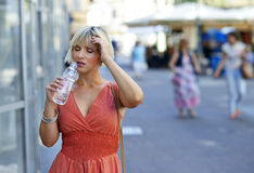 Woman with water bottle in the city Royalty Free Stock Image